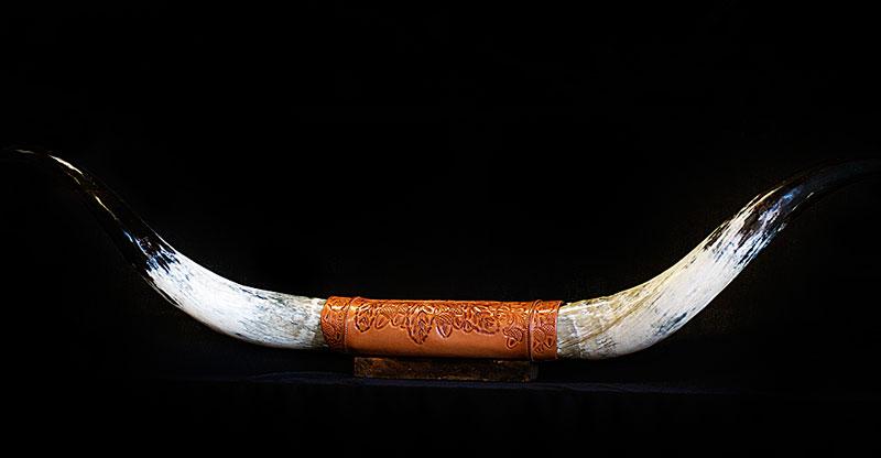 Custom leather work on cow horns